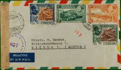 """(Ethiopia) Imprint etiquette air cover to Vienna, no arrival ds, franked 60c canc Addis Ababa dr. cds, sealed brown tape, also violet """"Osterrieichhische zensurestelle/857/z1"""" circular currency control mark."""