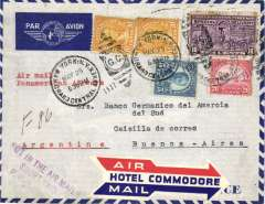 """(United States) New York to Buenos Aires, bs 16/6, franked 10c Special delivery + 45c ordinary, airmail envelope, typed 'Air Mail/Panam', red/white/blue 'Air/Hotel Commodore/Mail' arrow etiquette, violet """"Not In The Air Mail/Short Paid/PONYD"""" hs. Nice item."""