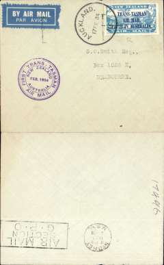 """(New Zealand) CP Ulm, First official mail, New Zealand to Australia, bs 17/2, plain airmail etiquette cover franked 7d """"Trans Tasman"""" opt, official violet cachet."""
