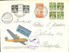 (Denmark) F/F Slagelse to Copenhagen, 6/9 arrival ds on front, red/yellow/cream souvenir cover with picture of plane in flight franked 38o inc 10o air, special  Slagelse postmark, circular violet flight cachet showing map of route.