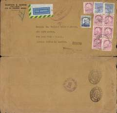 "(Brazil) WWII, high frank uncensored commercial airmail, Rio de Janeiro to New York, bs 12/6, printed Momsen & Harris corner cover franked 10,000 R x 7, 5000R, and 400R x2, red oval ""U.S.Customs/Free of Duty/N.M.G./Port of New York"" hand stamp tying airmail etiquette."