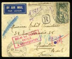 "(French Indian Settlements) Early WWII uncensored pre Armistice airmail from French India to France, registered (hs) airmail etiquette cover, Pondicherry to Marseilles, bs 7/6/40, franked 1936 International Exhibition Paris 50c, canc 'Inde Francais/27.4.1940/Pondicherry' cds, fine strike red framed ""Delai de Garde/Expire/a Representer' hs ( Extension Time for Safekeeping has Expired), faint black boxed 'Return to Sender' hs. French rule continued until 31 October 1954. Scarce WWII airmail."