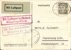 """(Danzig) Airmail service to Germany carried by a Deutche Lufthansa flight with Junkers G23 aircraft, Danzig to Insterbug, East Prussia, no arrival ds, red """"Mit Luftpost befordert./Kononigsberg (Pr)1"""" transit cachet on front, Junkers G23 airmail postcard franked 5pf PC rate + 10pf airmail supplement, canc oval Danzig Luftpost ds. No air connection from Konigsberg to Insterburg so forwarded by train and endorsed with scarce violet """"Mit Zug weiterbefordern/Konigsberg Pr. 1."""" on front, German """"Mit Luftpost"""" airmai Label."""