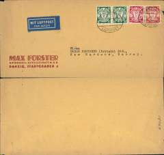 """(Danzig) Airmail service to United Kingdom, Danzig to Kew Gardens, no arrival ds, Max Forster corner cover, 10x20cm, correctly franked 40pf foreign letter, 20pf airmail (1938 defins 10pf x2, 15pf, 25pf), canc oval Danzig Luftpost ds, blue """"Mit Luftpost"""" airmail Label, flown by Lufthansa to Croydon via Berlin. Non invasive closed nick lh edge, otherwise fine."""