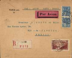 (France) Aeropostale registered cover postmarked Paris June 8, 1929 to Rio de Janeiro (Brazil) with arrival b/s June 23. Red airmail label. Commercial envelope with map on reverse and Paris Institute stamp. Small window cutting out return address. Franking includes a good copy of Sc.253 (Pont du Gard 20 Fr. stamp) valued at $32.50 (used) in 1998.