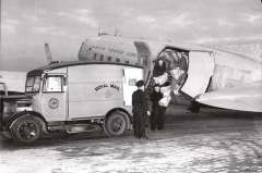 (Ephemera) Manchester-Dublin-Belfast Air Mail Service, loading mail into BEA plane from a PO van, 1951, superb B&W photograph on PPC, unused.