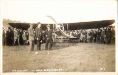 (Ephemera) Henri Salmet standing by his Bleriot Monoplane at the Daily Mail circuit of Britain Meeting 1912 , with spectators nearby, unused B&W PPC .