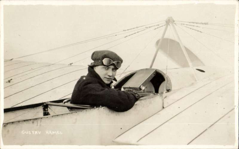 """(Ephemera) Gustav Hamel sitting in the cockpit of his aeroplane which appears to be a Bleriot, original B&W PPC, verso message, """"Hamel, Looping the loop, Odd Down, Bath April 4th 1914""""."""