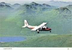 (Ephemera) Loganair Islander in flight, in company livery, colour PPC of official photo.