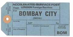 (Ephemera) Unused blue/black GB PO International mail bag tag for accelerated surface post from London Foreign Section to Bombay City, sections for Date of Despatch, Airport of Transhipment, and Airport Destination BOM. Date unknown.