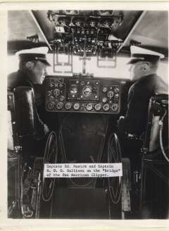 (Ephemera) Captains Ed Musik and R.O.D. Sullivan 'on the bridge' of the Pan-American Clipper, c1937, a fine B&W photograph of the period, not a photoscan reproduction, 25x20cm.