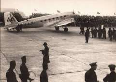(Ephemera) Uiver Memorial Flight, KLM DC2  PH-AJU on tarmac at Schipol Airport with welcoming crowd, B&W reproduction PPC.