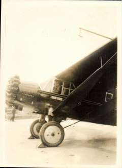 """(Ephemera) Bellanca monoplane """"Leonardo da Vinci"""" on the ground with Capt. Pond at the controls, original sepia photograph, 6x9cm. Flown, 1934, by George R.Pond and Cesare Sabelli in an attempted non-stop flight from FBF to Rome, but were forced to land at Lahinch after 32 hours due to a fuel system problem. Later they flew to Rome. This was the 8th transatlantic flight."""