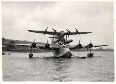 (Ephemera) Short-Mayo composite moored, showing the S.21 Maia registrationG-ADHKfitted with a trestle or pylon on the top of the fuselage and supporting the Short S.20 Mercury(G-ADHJ). Original B&W press Agency, Fleet Street, London copyright photograph, 16x11cm.