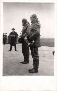 (Ephemera) Banhidi and Bisitsante, two famous Hungarian pilots of the Gerle 13 biplane, original unused B&W photocard. Bבnhidi achieved fame with the Gerle 13 when in 1933 he made a long-distance flight of 12,258 km around the Mediterranean. Later the same year, he flew from Hungary through northern Europe to England and back to Hungary,his route taking him from Debrecen to Rapla, Helsingfors, Stockholm, Copenhagen, Croydon, and then non-stop back to Debrecen.