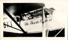 """(Ephemera) """"The Heart's Content"""", DH Puss Moth used by James Mollison on his Atlantic flight, August 1932. B&W photograph of the period, 12x7cm, showing cabin, wing struts and the plane's name."""