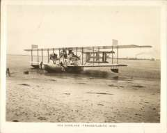 (Ephemera) The NC-4 sealane, unused original sepia photograph, 13x10cm. The NC4 was a  designed by Glenn Curtiss and his team, and manufactured by Curtiss Aeroplane and Motor Company. In May 1919, the NC-4 became the first aircraft to fly across the Atlantic Ocean, starting in the United States and making the crossing as far as Lisbon, Portugal, in 19 days.