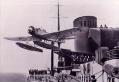 (Ephemera) Heinkel HE 12 (registration D-1717) on board SS Bremen when she departed on her maiden voyage in 1929. The Heinkel HE 12 D-17171 was a pontoon-equipped mail plane designed to be launched by catapult from a liner at sea. B&W reproduction photograph, 15x10cm.