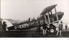 (Ephemera) DH.14A, a two-seat long-range mail plane registered G-EAPY, was bought by F.S. Cotton who intended to try for the Australian government's £10,000 prize for a flight between England and Australia. His plans were overtaken by events when Keith and Ross Smith won the prize before Cotton was ready. The aircraft did attempt the first flight between London and Cape Town in February 1920, but it only got as far as Italy, where it force-landed near Messina. B&W photograph published by Real Photographs Co Ltd, 14x9cm.