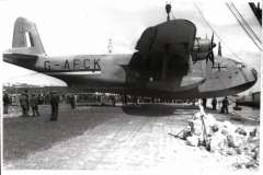 (Ephemera) Golden Horn G-AFCK, designed as an enlarged Short C-Class Empire flying boat. In 1940 impressed (along with their crews) into the RAF, before it could start civilian operation. In December 1941 returned, to BOAC and fitted out for 40 passengers in 'austerity' seating to operate between the UK and Nigeria. Original  'Real Photographs Co. Ltd' glossy B&W photograph, 15x9cm, c1940.