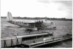 (Ephemera) Short S30 C Class flying boat 'Clyde' at mooring. The first Southampton to Karachi service was by G-AFCX Clyde on 3rd July 1939. On 1st November 1939, Imperial Airways ceased to exist with the creation of BOAC, the British Overseas Airways Corporation. The transatlantic link was resumed in 1940, when the darkly painted and camouflaged Short S.30s G-AFCX Clyde and G-AFCZ Clare made six return crossings of the Atlantic with passengers. Original  'Real Photographs Co. Ltd' glossy B&W photograph, 15x9cm, c1940.
