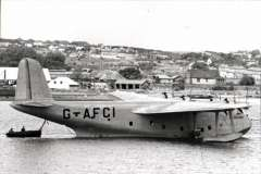 (Ephemera) Short S30 C Class flying boat 'Golden Hind' at mooring. Impressed into RAF service in 1940 (along with its crew, before it could start civilian operation. Returned to BOAC in December 1941 where it was employed on other routes in UK and West Africa until the end of the war, and remained in service with BOAC until retired in 1947. Original  'Real Photographs Co. Ltd' glossy B&W photograph, 15x9cm, c1940.