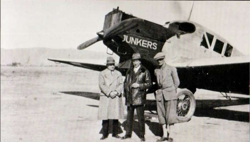 (Ephemera) Lloyd Aero Boliviano, close up of Junkers F-13 with, from left to right, Dr. Anibal Pena, Director of LAB, Herman Schroth, chief pilot, and a second pilot Helmers,  B&W photograph, 14x8cm, c1930.