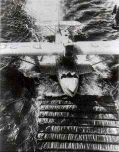 (Ephemera) Dornier Wal taxi-ing onto the drag sail towewd behind the 'Westfalen' prior to being lifted aboard. B&W photograph, 10x12cm.