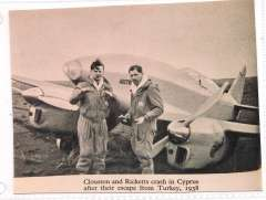 """(Ephemera) Clouston and Ricketts standing beside their DH Comet in Cyprus where their first attempt on the England-Australia record ended due to undercarriage problems. The plane, a DH Comet, had been renamed  """"Australian Anniversary"""" for this, their first attempt, which started on February 6, 1938. B&W photo, 12x9cm."""