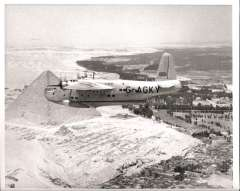 (Ephemera) BOAC Sunderland flying boat G-AGKY 'Hungerford' flying over the Pyramids. In 1946 first commercial flying boat to visit China and Japan, sold to Aquilla Airways in 1948. Original BOAC B&W photograph 26x21cm.