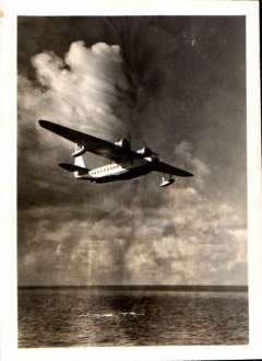 (Ephemera) Sikorsky S-43 in flight, B&W photograph made from the original negative, 10x8cm, c1936. The S-43 was used primarily by Pan American World Airways for flights to Cuba and within Latin America.