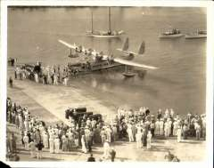 (Ephemera) Sikorsky S-42 survey flight to Hawaii 1935, crowd greeting S-42 on arrival at Pearl Harbour. B&W photograph made from the original negative, 12x9cm. Tiny corner bend.