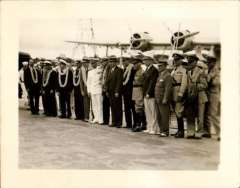 (Ephemera) Sikorsky S-42 survey flight to Hawaii 1935, arrival in Hawaii, crew with local dignitaries, and plane to rear. B&W photograph made from the original negative, 12x9cm.