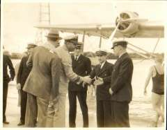 (Ephemera) Sikorsky S-42 survey flight to Hawaii 1935. Three crew members being greeted by local dignitaries on arrival at Pearl Harbour,  B&W photograph taken April 1, 1935, 12x9cm