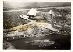 """(Ephemera) Sikorsky S-40, 'American Clipper', flying over New York en route to Washington, 1931, original Lindbergh B&W photograph 1931. Pan Am's first  passenger carrying service was initiated on the November 19, 1931, with a S-40 piloted by Charles Lindbergh, flying from Miami, Florida to the Panama Canal Zone.The S-40 was Pan American's first large flying boat. The American Clipper served as the flagship of Pan Am's clipper fleet and this aircraft model was the first to earn the popular designation of """"Clipper"""" or """"Pan Am Clipper""""."""