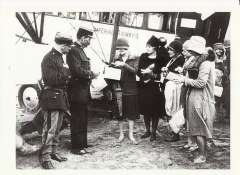 (Ephemera) Welcome to France, a group of ladies handing their passports to French customs officers whilst standing beside an Imperial Airways aircraft, B&W photoscan of the period, c1925,