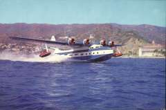 (Ephemera) Catalina Airlines Sikorsky VS 44-A Flying Boat taking off from Catalina Island, Avalon. Beautiful colour photocard, 22x15cm.