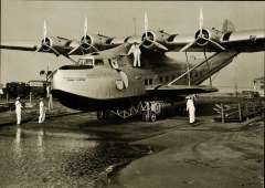 (Ephemera) China Clipper, Martin M-130 on the slipway prior to the inaugural flight to the The Orient,, PPC with original B&W photograph, 18x13cm.