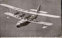 (Ephemera) Imperial Airways Flying Boat 'Scipio' in flight, Tuck's B&W photocard used. A particularly attractive shot taken from above and slightly in front. A few edge rubs, but otherwise good. See scan.