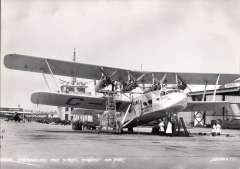 (Ephemera) Imperial Airways airliner 'Syrinx' undergoing overhaul on the tarmac at Croydon Airport, large black and white photo card 17x11cm,  unused.