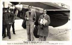 (Ephemera) Mac Robertson Race, London to Australia and back, O.Cathcart-Jones and K.F.Weller standing by plane Comet G-AACSR after their record flight Ausralia and back in 13 days, origibal B&W PPC signed in ink Owen Cathcart Jones.,