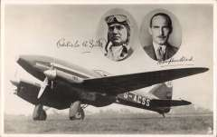 (Ephemera) Mac Robertson Race, England to Australia, C.W.A.Scott & T.Campbell-Black, original unused Tuck's photocard showing their plane DH 88 G-ACSS 'Grosvenor House' with inset head and shoulders of both pilots with photo prints of their signatures below.