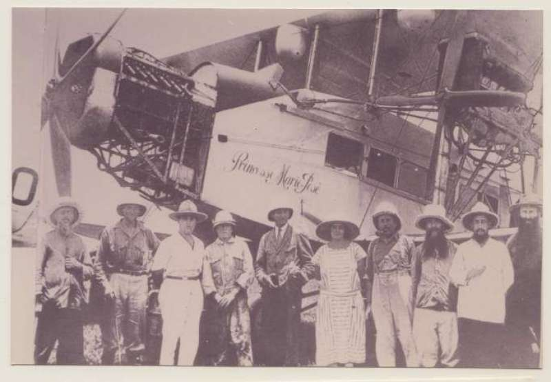 "(Ephemera) The Handley Page ""Princesse Marie Jose"" arriving in Leopoldville on April 3, 1925, sepia photograph ,15x10cm, showing plane and group of nine local dignitaries, among whom is like to be the pilot Lt. Thieffry."