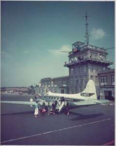 (Ephemera) Morton Air Services, beautiful colour photograph, 21x25cm and mounted on card 33x25cm, of G-AMYO De Havilland DH.104 Dove 1B on the tarmac with passengers loading at Croydon/Gatwick airport, c1960. Morton Air Services was one of the earliest post-World War II private, independent British airlines and was  formed in 1945. Image.