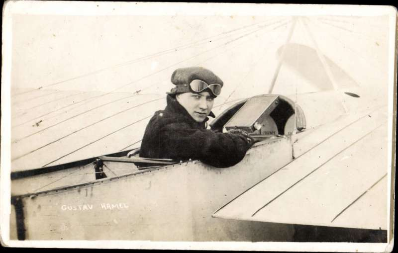 (Ephemera)  Gustav Hamel seated in cockpit, original B&W photocard, flew from Dover, across the English Channel and on to Cologne, and also with the  London-Windsor Coronation post.
