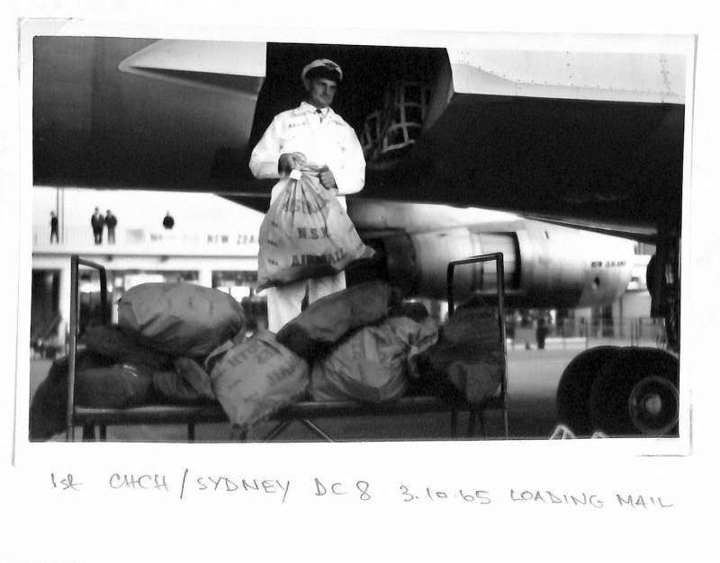 (Ephemera) Air New Zealand DC 8 on tarmac being loaded with mail prior to departure on F/F Christchurch to Sydney service, original B&W photograph, 11x17cm.