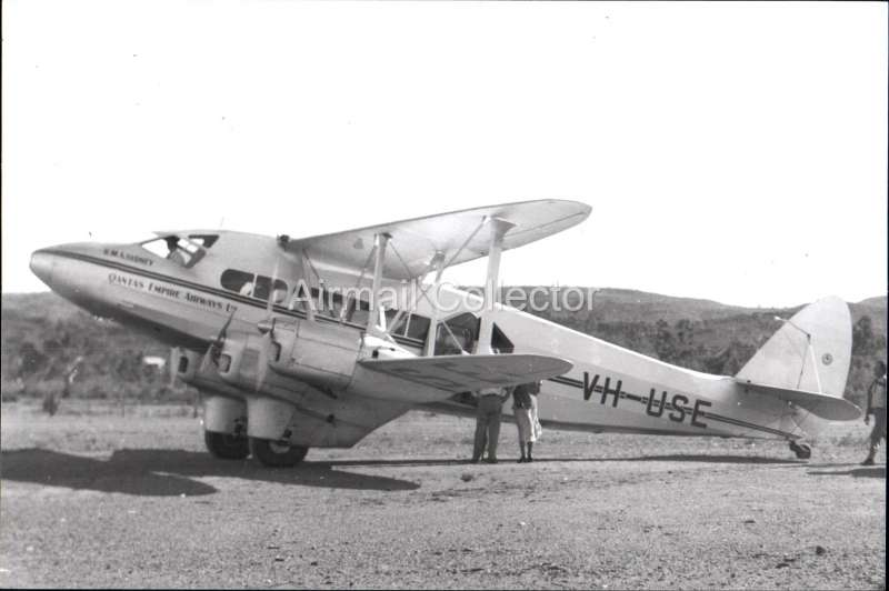 (Ephemera) RMA DH 86A  'Sydney', Qantas Empire Airways.  B&W photograph from an original negative clearly showing the plane's name and registration number, 10x15cm. Watermark for display only.