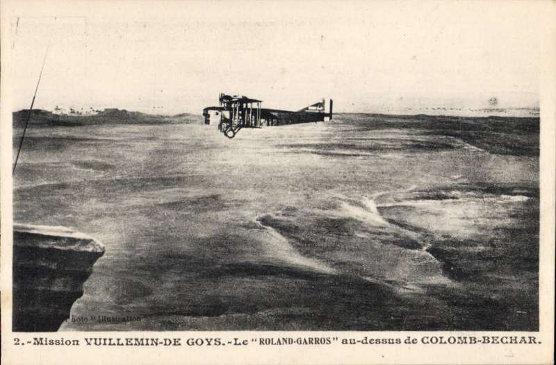 (Ephemera) French Air Mission commanded by Colonel de Goys to establish a Central African air route, one of the planes 'Le Rolandd Garros' flying over Colomb-Bechar. Original B&W PPC.