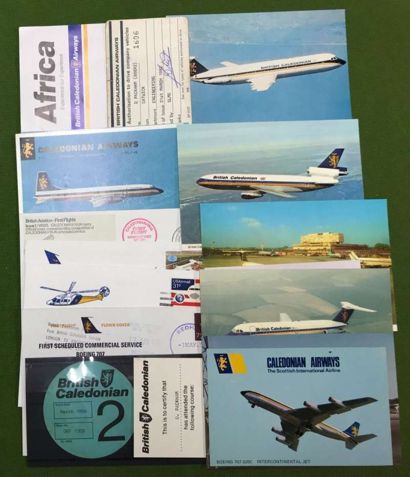 (Ephemera) Collection: BRITISH CALEDONIAN ephemera, 1970-88, superb collection of ephemera including captain's cap badge and wings, 12 unused PPCs of company planes, 4 FFCs, 2 baggage labels, 3 security passes, passenger ticket, phone card, timetable, 2 menus. (27 items.) All fine, see scans.