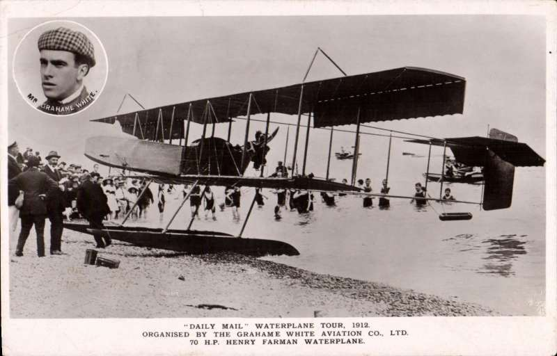 (Ephemera) Graham White head and shoulders inset on original B&W photocard showing 70 H.P Henry Farman waterplane on beach.